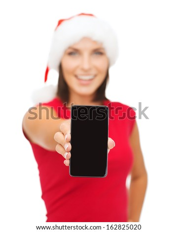 christmas, x-mas, electronics and gadget concept - smiling woman in santa helper hat with blank screen smartphone