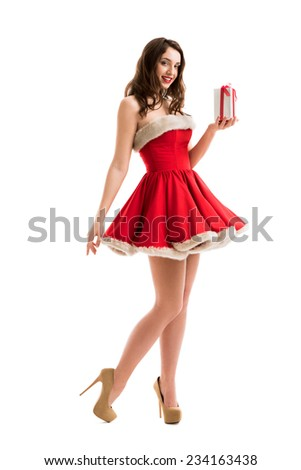 Christmas, x-mas, winter, happiness concept - smiling woman in Santa Claus dress with gift boxes