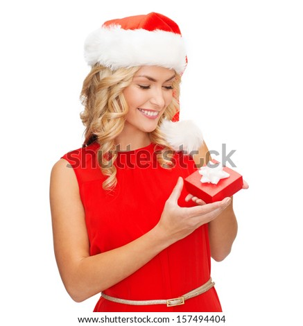 christmas, x-mas, winter, happiness concept - smiling woman in santa helper hat with small jewelry gift box - stock photo