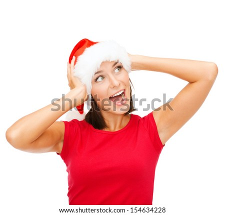 christmas, x-mas, winter, happiness concept - surprised woman in santa helper hat - stock photo