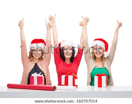 christmas, x-mas, winter, happiness concept - three smiling women in santa helper hats with gift boxes - stock photo