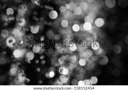 christmas xmas defocused raindrops backlit background wallpaper - stock photo