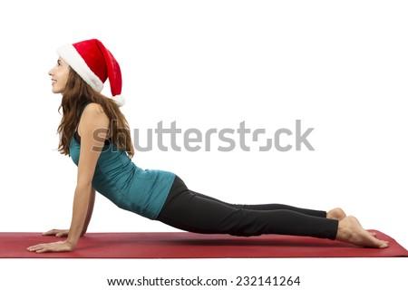 Christmas yoga woman doing upward facing dog - stock photo