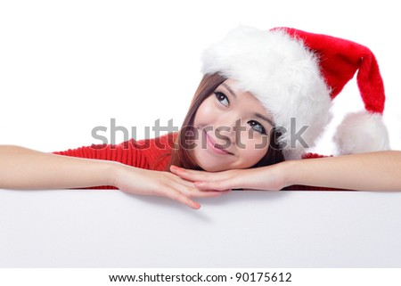 christmas young girl looking up and thinking with blank billboard banner sign. Beautiful and cute Asian female model Isolated on white background - stock photo