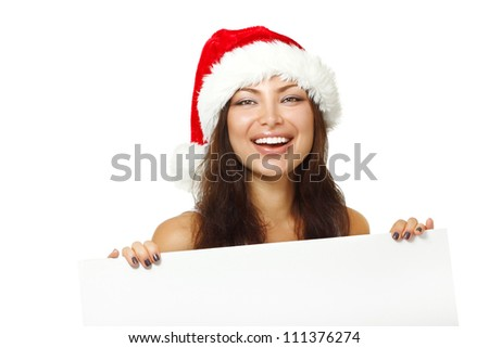 christmas young sexy woman happy smiling and holding empty banner, isolated on white background - stock photo