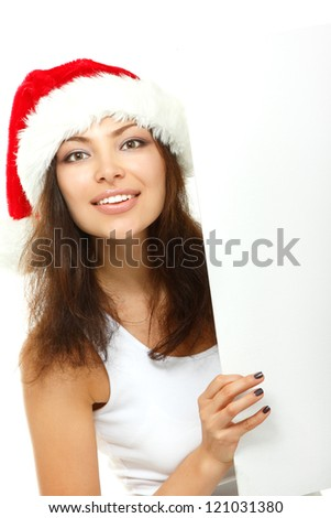 christmas young sexy woman happy smiling and holding empty banner over white background - stock photo