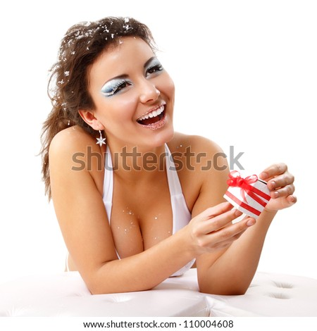 christmas young sexy woman happy smiling with present, isolated on white background - stock photo
