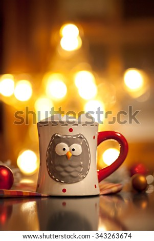 Christmasa cup from owl and gold star. Christmas background - stock photo