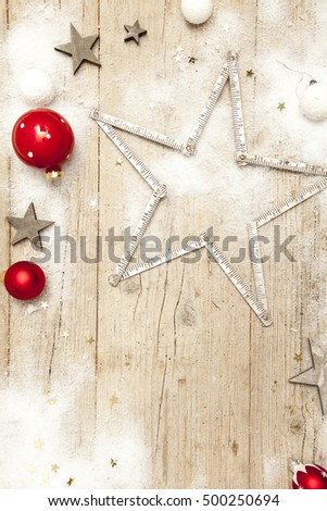 Christmassy grey wood background with xmas decoration