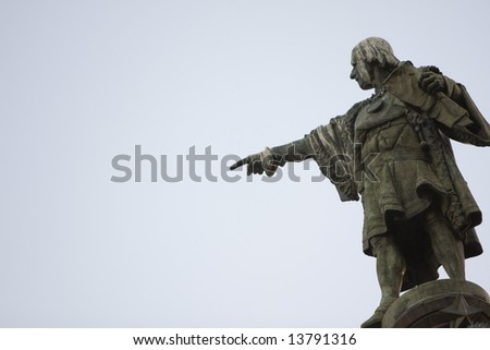 Christopher Columbus statue pointing to America - stock photo