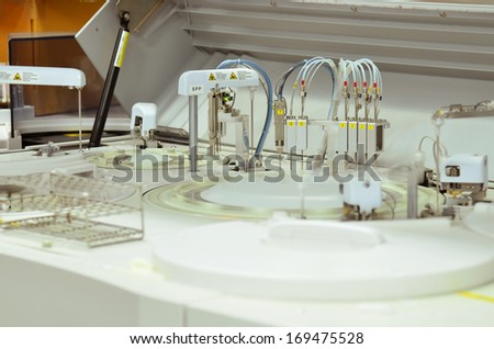 chromatograph with glass sample bottles - stock photo