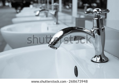 chrome faucet. - stock photo