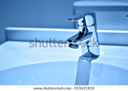 Chrome faucet with wash basin in blue tone