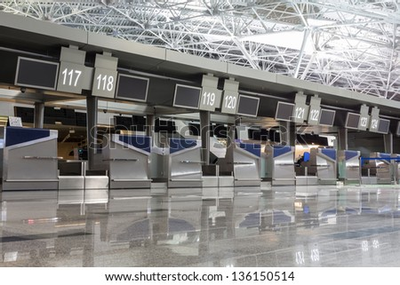 Chrome interior elements and floor with reflections in the airport terminal - stock photo