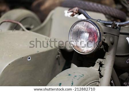 chrome, lights, vintage MILITARY MOTOR BIKE , close-up of the diagonal - stock photo