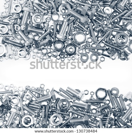 Chrome nuts and bolts closeup on plain background - stock photo