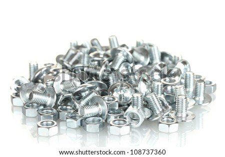 Chrome nuts and bolts on white background close-up - stock photo
