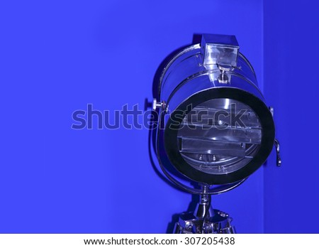 Chrome stage light taken closeup on blue background. - stock photo