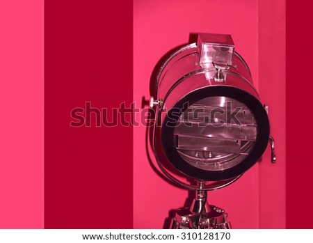 Chrome stage light taken closeup on red background. - stock photo