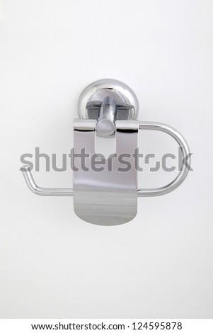 Chrome toilet paper holder - stock photo