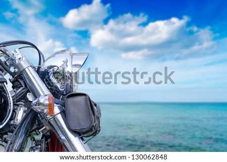 chromed motorcycle by the sea - stock photo