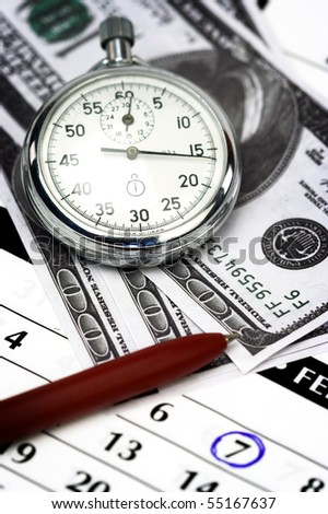 Chronometer and dollar bills close up - stock photo