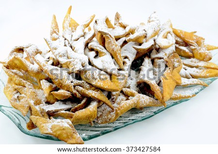 Chrust (faworek) funnel cake - Polish fried cookie (a kind of cracknels) with powdered sugar.