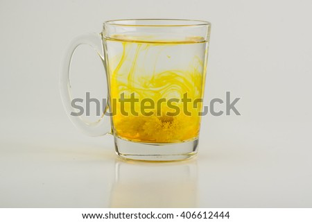 Chrysanthemum water in clear glass mug isolated on white background