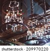Chrystal chandeliers close-up. Glamour background with copy space - stock photo
