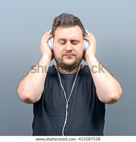 Chubby man enjoying music  - stock photo