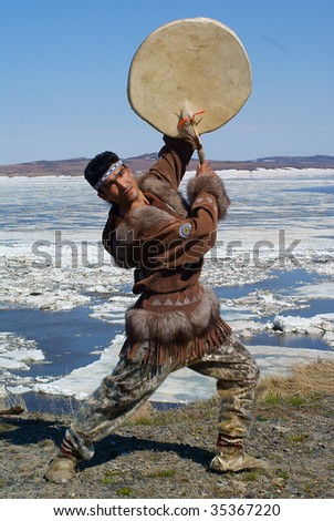Chukchi man dancing a folk dance - stock photo
