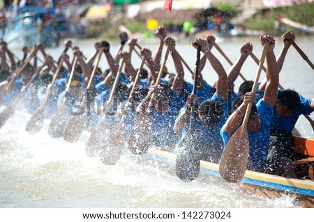 CHUMPHON ,THAILAND-NOV 3 : Unidentified rowers in Climbing Bows toward Snatching a Flag native Thai long boats compete during Native Long Boat Race Championship on Nov 3, 2012 in Chumphon ,Thailand . - stock photo