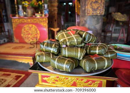 Chung cake on altar in old village communal house. Cooked square glutinous rice cake, Vietnamese lunar new year food