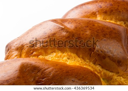 chunks large braided loaf on white background