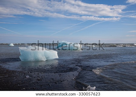 Chunks of glacier ice stranded on a lava beach in Iceland