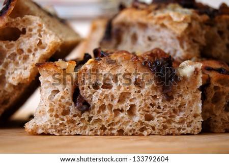 Chunks of italian bread on a wooden table - stock photo