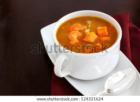 Chunky carrot and red lentil soup - stock photo