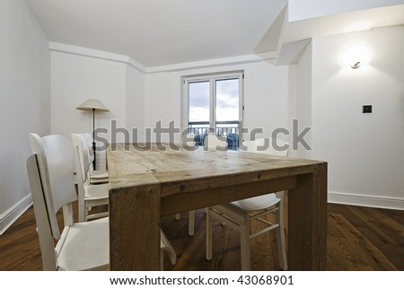 chunky hard wood dining table and chairs - stock photo