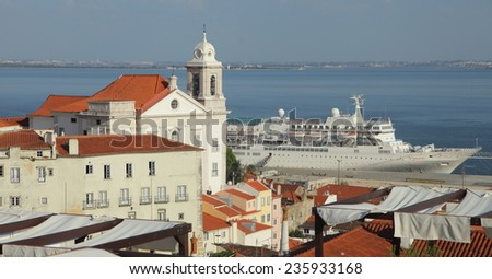 Church and a Ocean Liner in Lisbon - stock photo