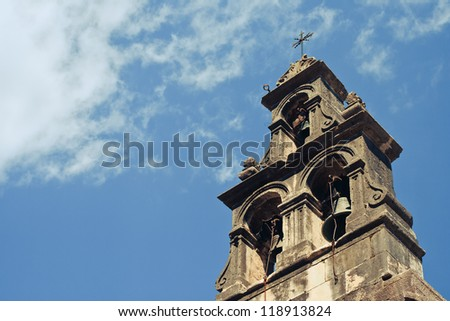 Church bell in front of the blue sky