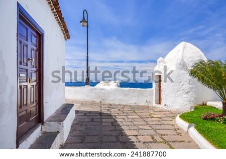 Church buildings on coastal promenade along ocean in Puerto de la Cruz, Tenerife, Canary Islands, Spain - stock photo