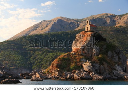 Church built on top of isolated island on Mediterranean sea - stock photo