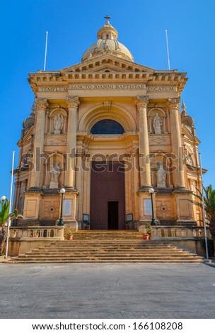 Church dedicated to St John the Baptist in Xewkija, in the island of Gozo, Malta. - stock photo