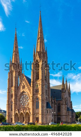 Church (Eglise) St. Paul in Strasbourg. Alsace region in France. Detail of big sacral building under the blue sky.