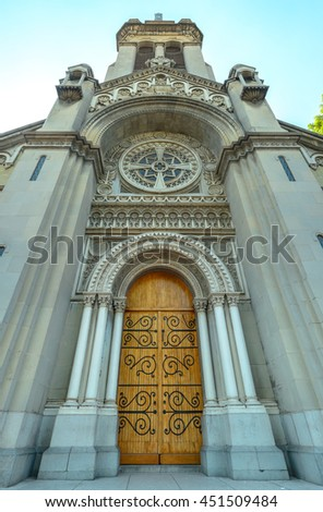 Church entrance with wooden door, extreme wide angle perspective - stock photo