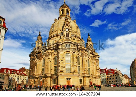 Church Frauenkirche in Dresden Germany on a sunny day with blue  - stock photo