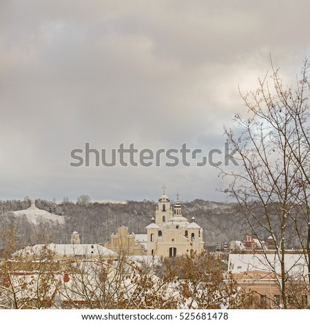 Church, hill of three crosses and roof of buildings in winter, view from hill, Vilnius, Lithuania
