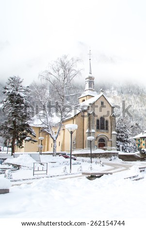 Church in Chamonix town, France, French Alps  in winter - stock photo