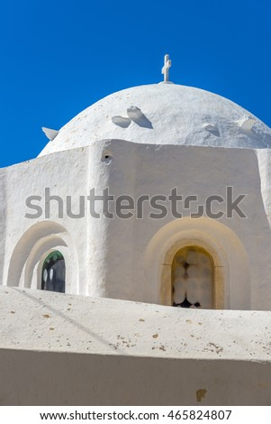 Church in Chora, Naxos, Greece. Traditional cycladic architecture. View through an archwall.