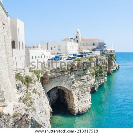church in front of adriatic sea in the Vieste Italy with cave on sea level